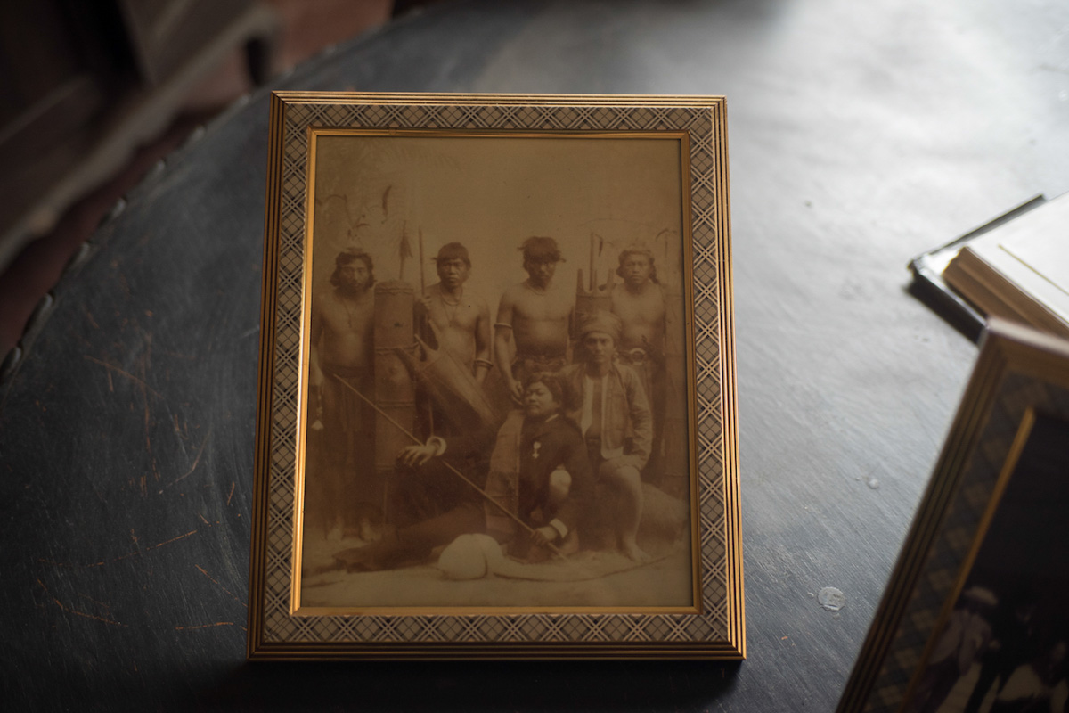 EXPOSITION. A framed photo of the family's ancestor, Gobernadorcillo Ismael Alzate y Astudillo, with Igorots presented at the Exposicion de las Islas Filipinas in Madrid, Spain, in 1887, which infuriated Dr Jose Rizal. Photo by Maverick Asio