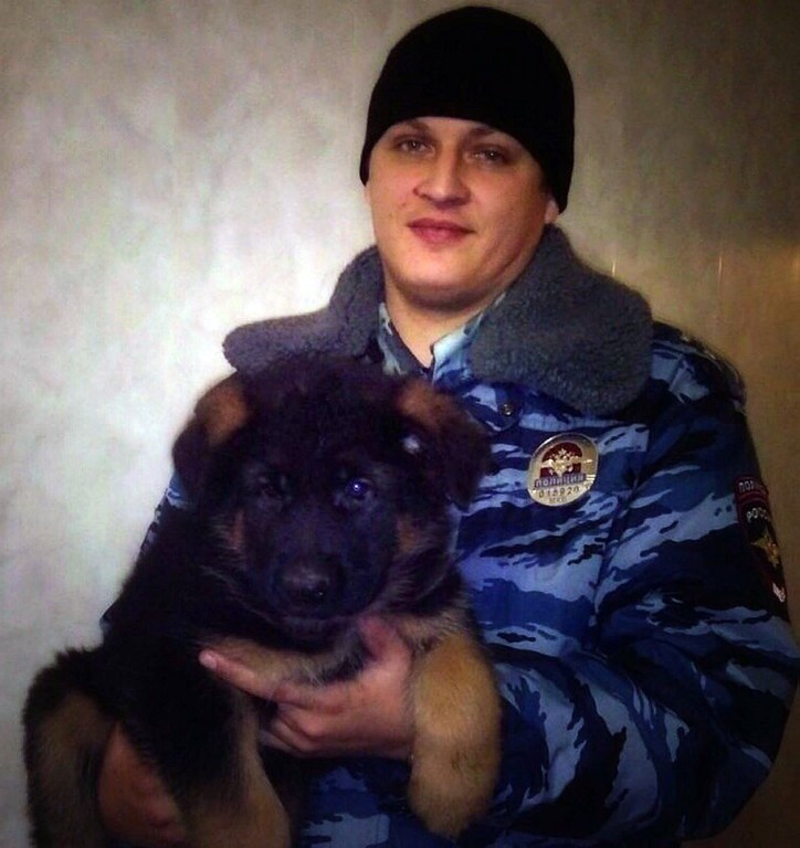 DOBRYNYA. This handout picture released on November 21, 2015 by Russia's Interior ministry shows a Russian officer holding a puppy named Dobrynya in Moscow. Photo by Russiau2019s Interior Ministry / AFP