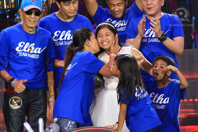 ELHA'S BIG WIN. Elha celebrates with family after her big win. Photo by Manman Dejeto/Rappler