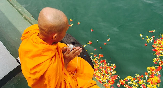 ONE WITH THE OCEAN. A Buddhist monk commits the ashes of Ko to the ocean. Photo from Walden Bello