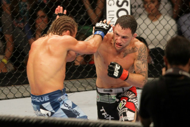 Frankie Edgar (R) has spent more time in a UFC octagon than anyone. Photo by Josh Albelda