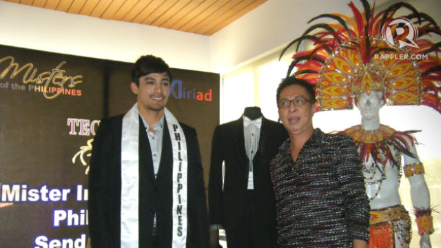 PROUDLY FILIPINO-MADE. Neil Perez poses with designer Olan Roque during his send-off. Olan is one of the designers of Neil's outfits for the Mister International in Korea. All photos by Alexa Villano/Rappler