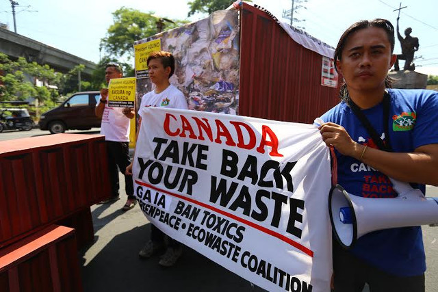 NOT A DUMPSITE. On May 4, 2015, Environmentalists tell President Benigno Aquino III to remind Canadian Prime Minister Stephen Harper that container vans of garbage from Canada are still stranded in Philippine ports. Photo by Gigie Cruz/BAN Toxics