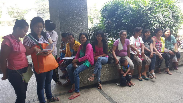 BREADWINNERS. The wives and children of the forest guards wait for them outside the MWSS building lobby.