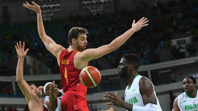 FINALLY. Pau Gasol (in red) and Spain notches a win against Nigeria. Mark RALSTON / AFP