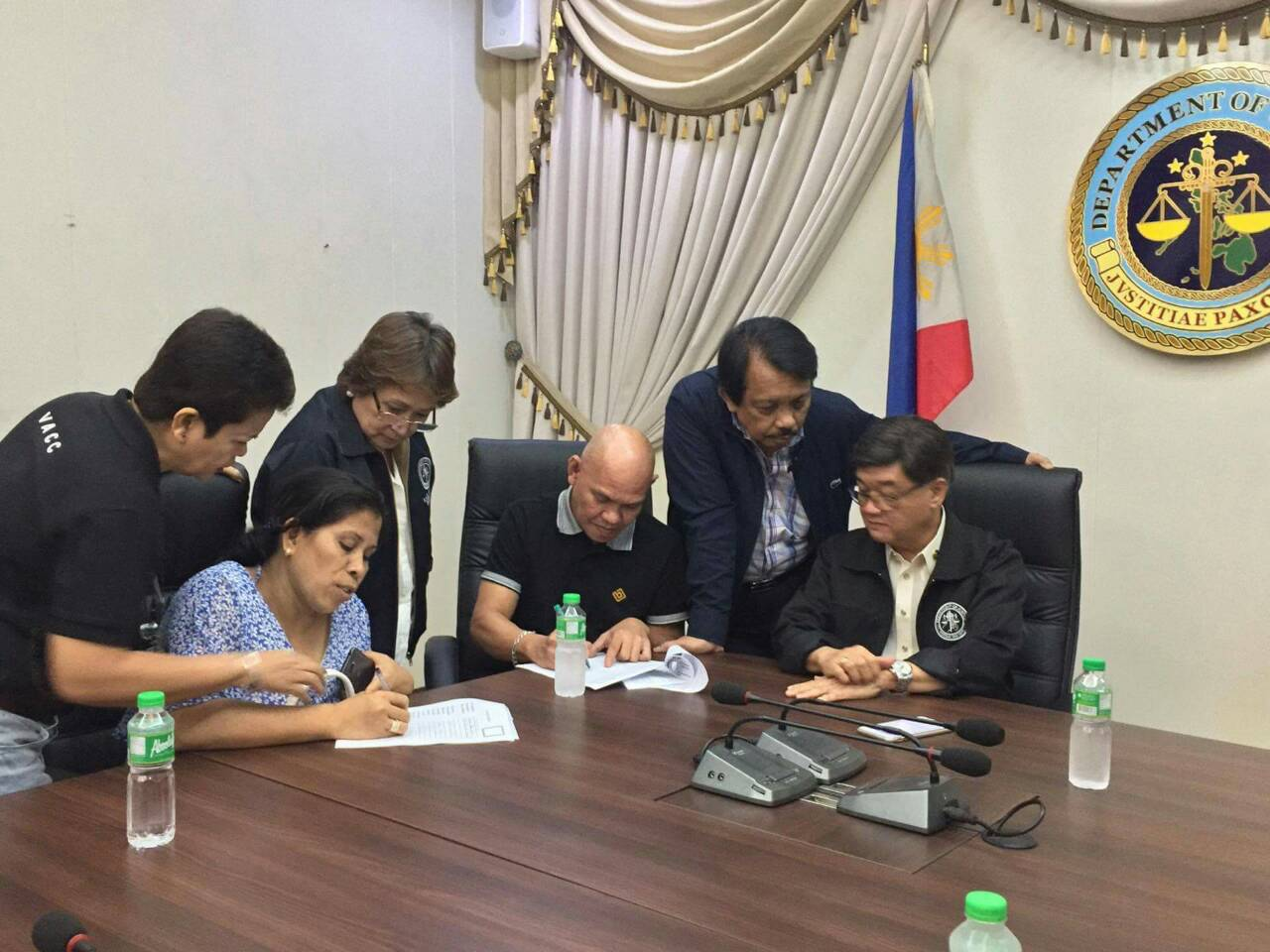 APPLICATION. Lorenza and Saldy delos Santos apply for the Witness Protection Program of the Department of Justice on August 29, 2017. With them is Justice Secretary Alexander Aguirre II and Dante Jimenez, president of the Volunteers Against Crime and Corruption (VACC). Photo courtesy of the DOJ