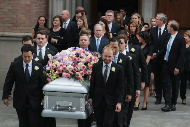FAREWELL. The coffin of former first lady Barbara Bush is carried from St. Martin's Episcopal Church following her funeral service on April 21, 2018 in Houston, Texas. Photo by Scott Olson/Getty Images/AFP