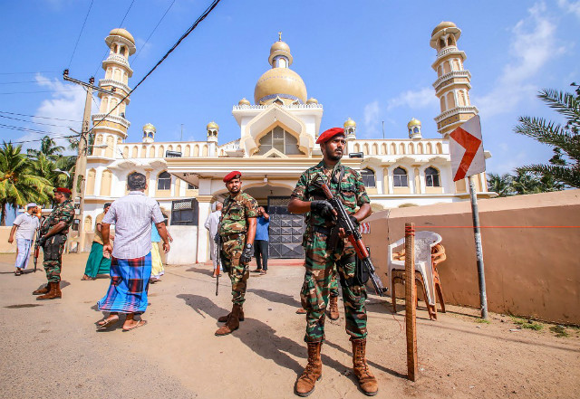 UNREST. Sri Lankan security personnel stand guard after clashes erupted between Christian and Muslim communities in Negombo on May 6, 2019. Photo by STR/AFP