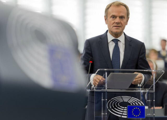 EU. European Union President Donald Tusk says improved relations would depend on progress on issues. File photo by AFP