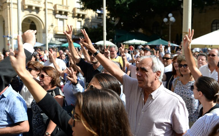 JUSTICE FOR DAPHNE. People gathered outside the law court in Valletta, Malta, on October 17, 2017 during a protest demanding for justice following the murder of Maltese journalist Daphne Caruana Galizia who was killed by a car bomb close to her home in Bidnija. Photo by Matthew Mirabelli/AFP