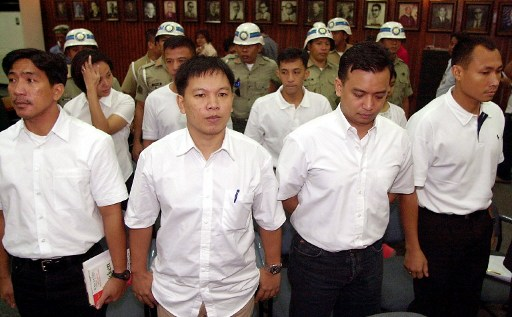 FACING THE COURT. Detained junior officers who led a failed coup, from left: Navy Lit Senior Grade James Layug, Army Captain Maestrecampo, Navy Lieautenant Senior Grade Antonio Trillanes and Marine Captain Gary Alejano. File photo by AFP