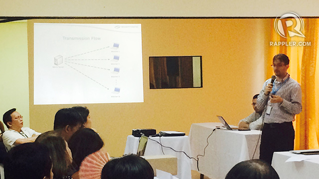 BRIEFING. Smartmatic project manager Marlon Garcia (R) and Comelec commissioner Christian Robert Lim (seated, L) give a briefing to political parties and media groups at the Pope Pius Catholic Center in Manila on April 29, 2016. Photo by Michael Bueza/Rappler