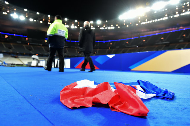 A French national flag lays on the ground in the stadium after the international friendly football match between France and Germany at Stade de Fance in Paris. Dozens of people have been killed in a series of attacks, which included explosions outside the stadium on Friday, November 13. Photo by UWE ANSPACH/EPA