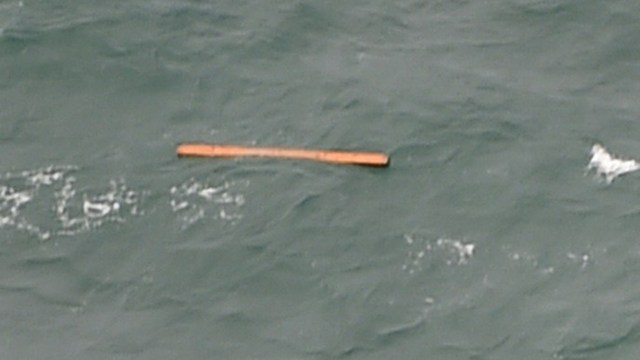 PLANE DEBRIS? This aerial view taken from an Indonesian search and rescue aircraft over the Java Sea shows floating debris spotted in the same area as other items being investigated by Indonesian authorities as possible objects from missing AirAsia flight QZ8501 on December 30, 2014. Photo by Bay Ismoyo/AFP