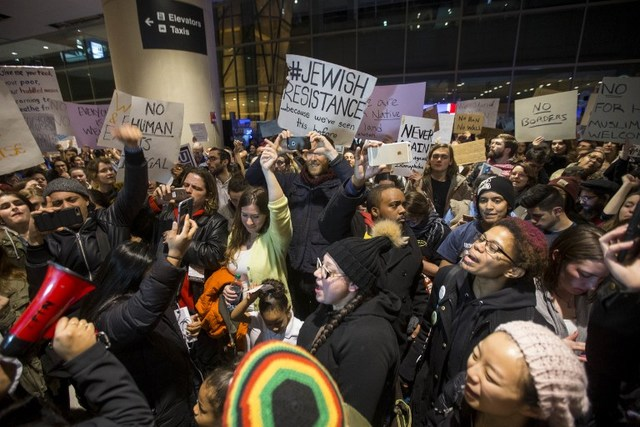 DEMONSTRATION. Protesters rally against the new ban on immigration issued by US President Donald Trump at Logan International Airport in Boston, Massachusetts on January 28, 2017. Photo by Scott Eisen/Getty Images/AFP