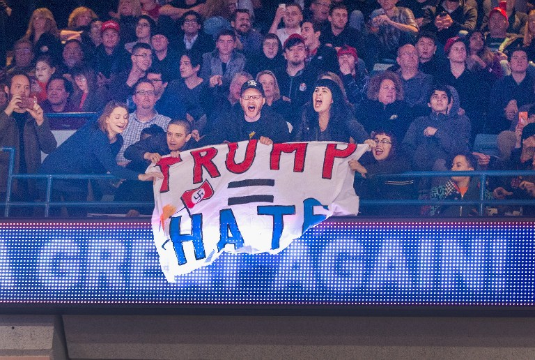 ANTI-TRUMP PROTESTERS. Demonstrators react after learning a rally for Republican presidential candidate Donald Trump at the University of Illinois at Chicago would be postponed on March 11, 2016 in Chicago, Illinois. Photo by Scott Olson/AFP