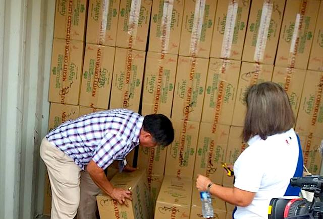 ANOTHER RAID. Customs officials inspect cigarette cartons inside a container van belonging to Mighty Corporation in Tacloban City on March 8, 2017. Photo by Jazmin Bonifacio/Rappler