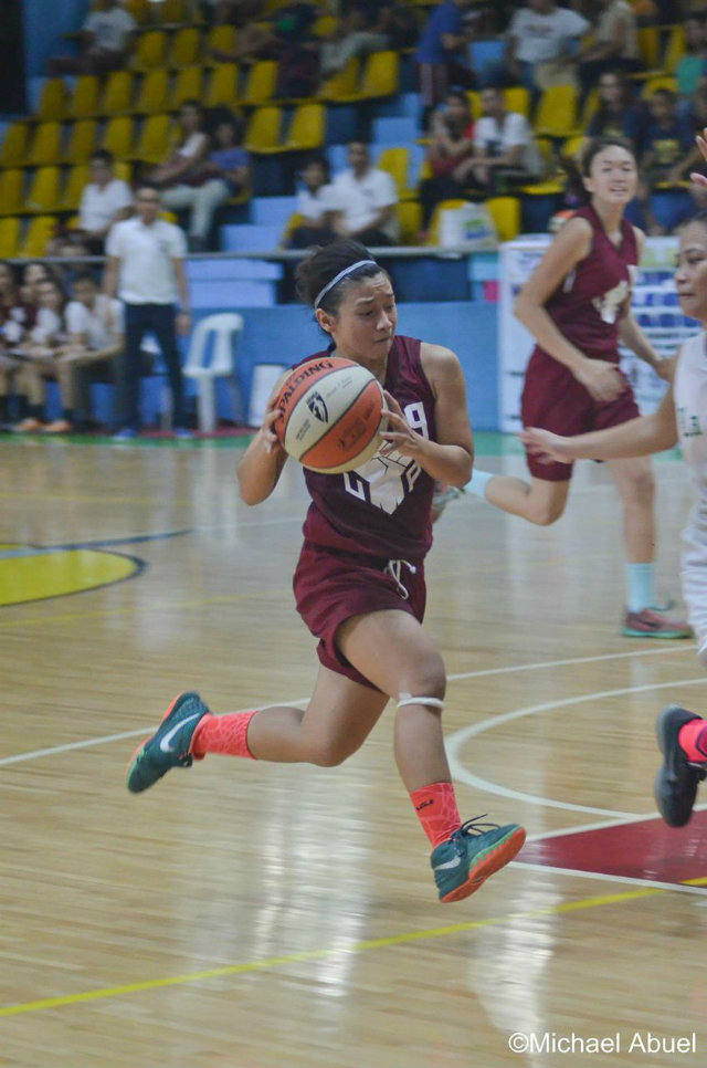 UPu2019s Jeanine Bautista (#9) drives to the hoop. Photo by Michael Abuel
