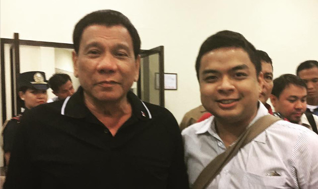 BETTER DAYS. President Rodrigo Duterte poses for a photo with PCUP chairman Terry Ridon. Photo from Terry Ridon Facebook account
