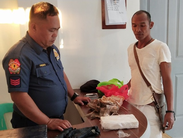 FOUND BY A PASSERBY. A local turns over a cocaine brick u2013 marked 'Lexus u2013 he found in Camarines Norte. PNP photo