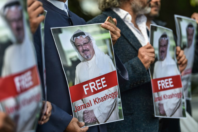 FREE. Protestors hold pictures of missing journalist Jamal Khashoggi during a demonstration in front of the Saudi Arabian consulate in Istanbul on October 5, 2018. Photo by Ozam Kose/AFP