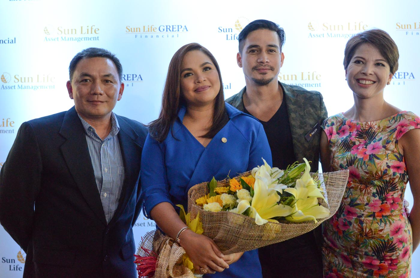 MONEY FOR LIFE. Judy Ann Santos-Agoncillo joins longtime Sun Life ambassador Piolo Pascual for the Money for Life campaign. The two stars are flanked by Gerry Tirona, Sun Life Grepa Financial, Inc. Marketing Head (left) and Mylene Daez-Lopa, Chief Marketing Officer for Sun Life of Canada (Philippines), Inc. (right). Photo by Alecs Ongcal/Rappler