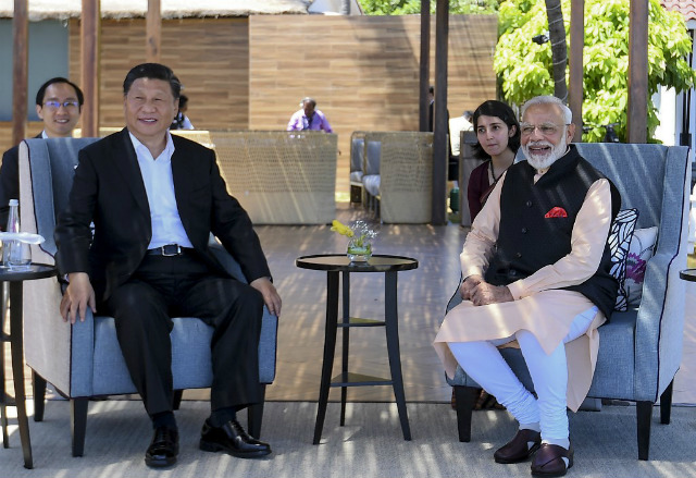 ALLIES. India's Prime Minister Narendra Modi (R) along with China's President Xi Jinping look on during their summit in Mahabalipuram in Tamil Nadu state. Handout photo by PIB/AFP