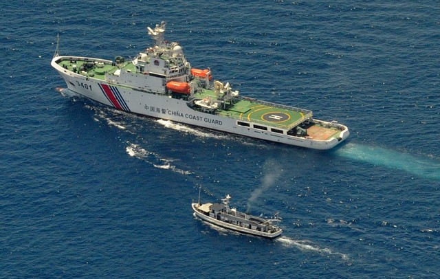 CODE OF CONDUCT. A China Coast Guard ship (top) and a Philippine supply boat engage in a stand off as the Philippine boat attempts to reach the Second Thomas Shoal, a remote South China Sea a reef claimed by both countries, on March 29, 2014. File photo by Jay Directo/AFP
