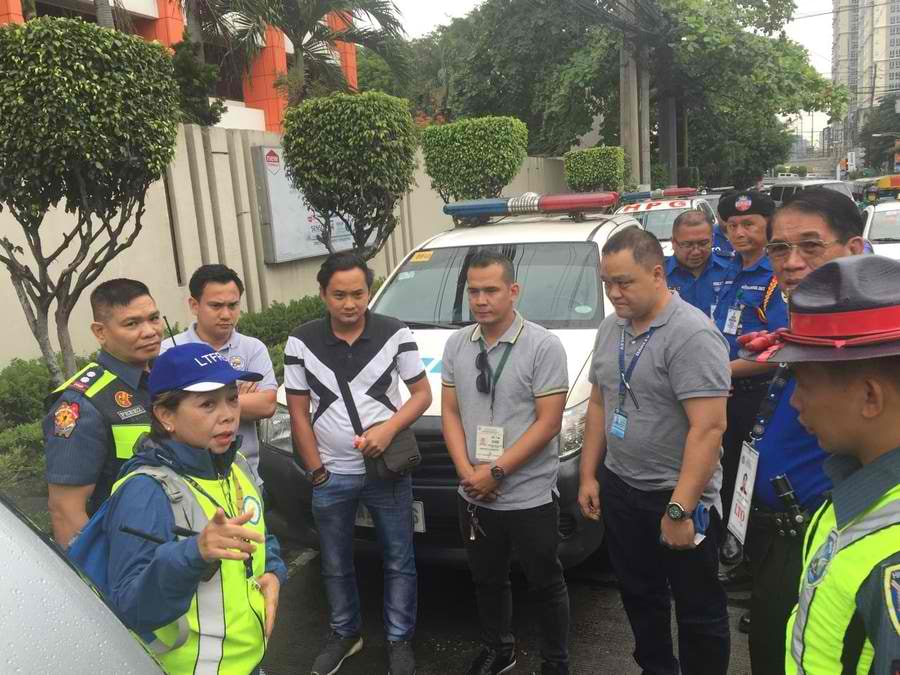 APPREHENSION. LTFRB board member Aileen Lizada catches Angkas drivers without permits. LTFRB photo