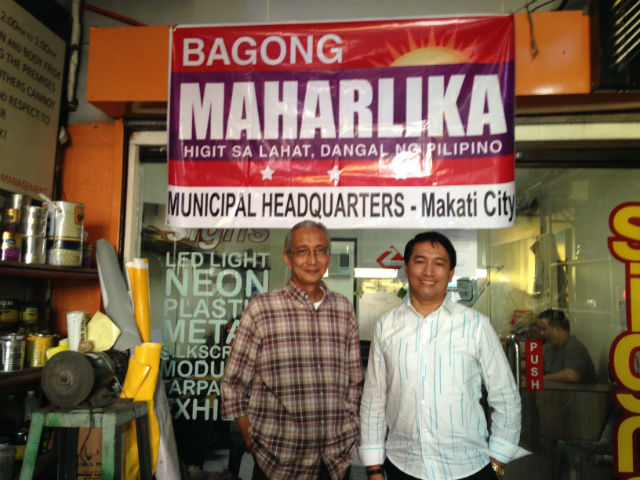 BAGONG MAHARLIKA TANDEM. Edgardo Padrigon and Jimboy Jumawan pose outside their Partido Bagong Maharlika's municipal headquarters in Makati. Photo by Mara Cepeda/Rappler