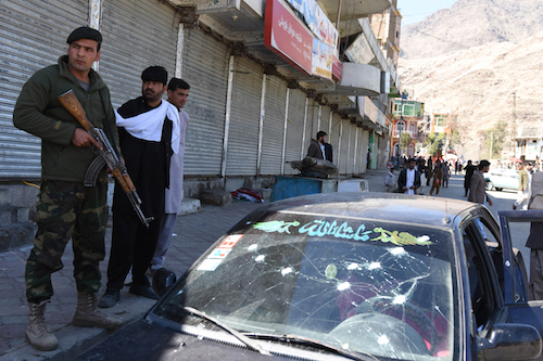 SUICIDE BOMB. Afghan security officials inspect the scene of a suicide bomb attack that targeted the provincial governor's office in Asadabad, Kunar province, Afghanistan.  Photo by Ghulamullah Habibi/EPA