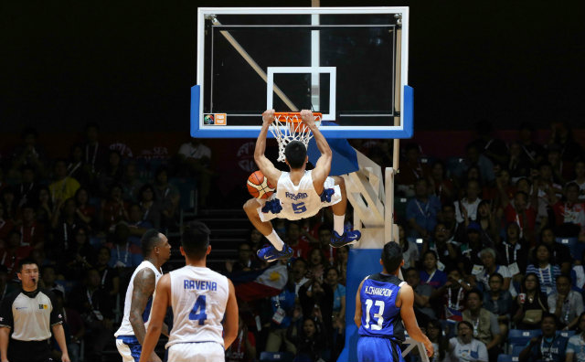 Troy Rosario throws down two of his game-high 27 points. Photo by Singapore SEA Games Organising Committee/Action Images via Reuters