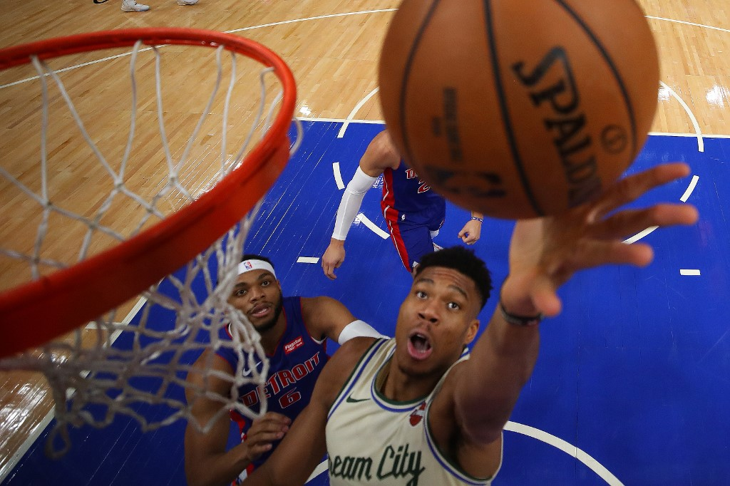 ON A ROLL. File photo of Giannis Antetokounmpo of the Milwaukee Bucks gets a shot off past Bruce Brown of the Detroit Pistons during their game in Detroit, Michigan. Photo by Gregory Shamus/Getty Images/AFP