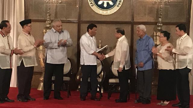 PRESIDENTIAL APPROVAL. President Rodrigo Duterte receives the draft constitution from the Consultative Committee. PTV photo