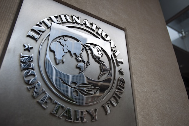 A file photo dated May 18, 2011 showing the sign of the International Monetary Fund at the entrance of the Headquarters of the IMF, also known as building HQ2, in Washington, DC, USA. Jim Lo Scalzo / EPA