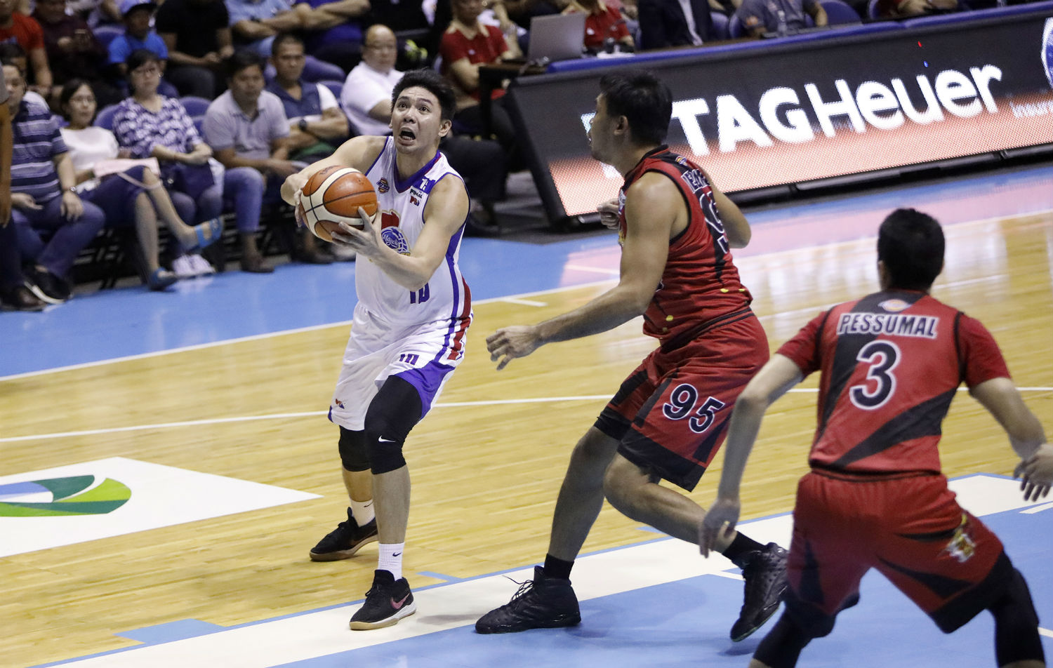 STAR. Ian Sangalang shines the brightest as the Magnolia Hotshots stun the San Miguel Beermen in Game 1 of the Philippine Cup finals. Photo by PBA Images