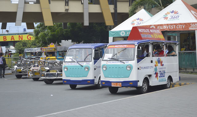 POLLUTION- FREE. EJeepneys wait for passengers at a terminal in Filinvest City in Alabang. Photo by Rommel T. Juan