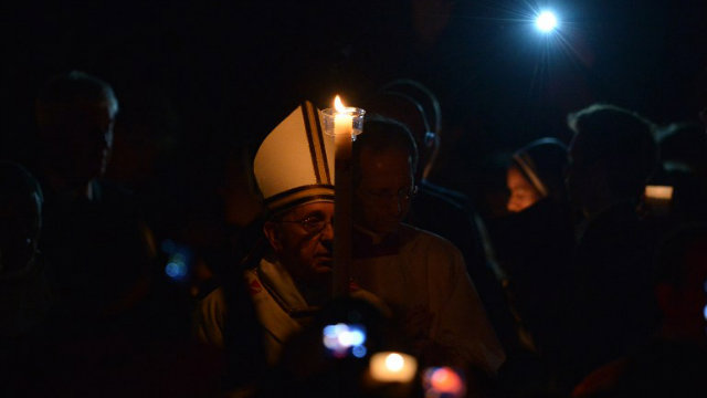 SPREAD THE WORD. Pope Francis holds a candle during the Easter Vigil at the St Peter basilica in Vatican. Photo by Filippo Monteforte/AFP