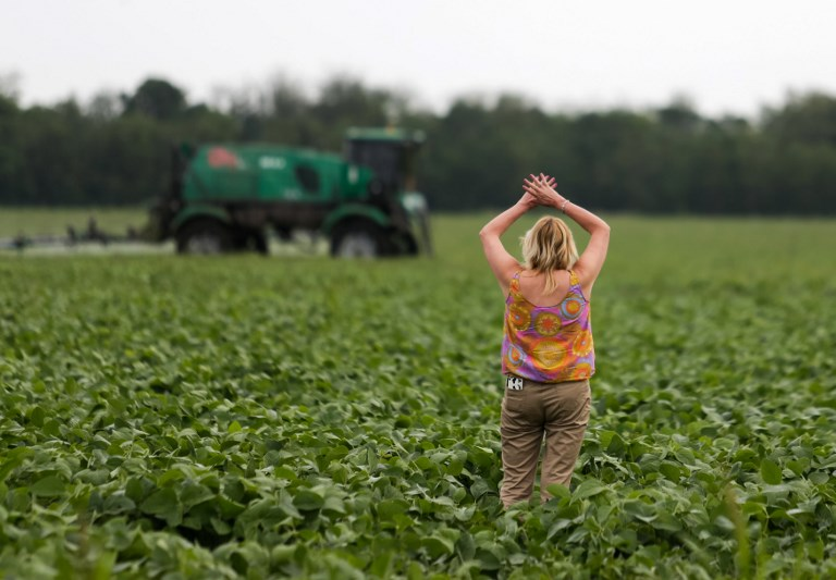 PROTEST. Argentine environmentalist Sofia Gatica tries to stop the spraying at a soybean field in Dique Chico, Cordoba province, Argentina, on January 20, 2018. Soybean fields in Argentina are often fumigated with glyphosate, a herbicide which is probably carcinogenic according to the World Health Organization (WHO), but which is needed to maintain crops of transgenic seeds. Photo by Diego Lima/AFP