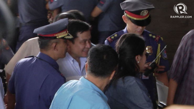 SURRENDER. Senator Jinggoy Estrada (2nd from left) arrives at the PNP Multipurpose Hall, 23 June 2014. Franz Lopez/Rappler
