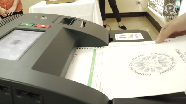 VOTING. Remind the voter to use the ballot secrecy folder when inserting the ballot in the VCM. Rappler photo
