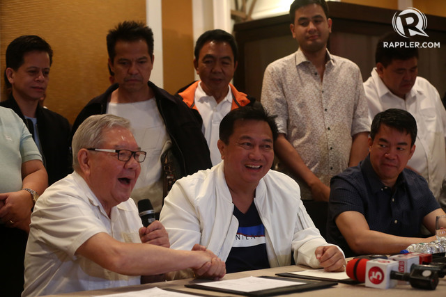 COMPROMISE. Former speaker and Quezon City 4th District Representative Feliciano Belmonte Jr and Speaker Pantaleon Alvarez shake hands after LP signed a coalition agreement with PDP-Laban on July 24, 2016. File photo by Ben Nabong/Rappler