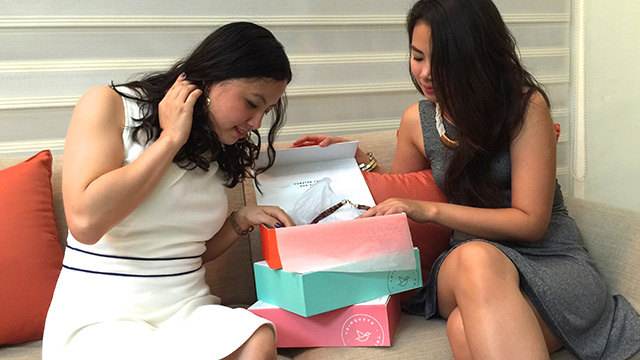 MONETIZATION. Weslyn Reyes (left) and Erika Puyat share users do have the option to choose 1 box of Trinquets for P950 ($21.37), but are incentivized via a small discount to avail of 3 boxes for P850 ($19.12).