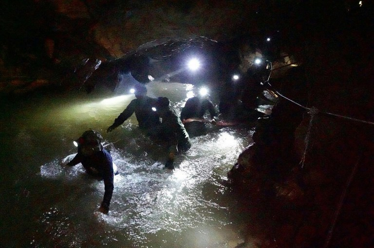 RESCUE OPS. This file photo taken and released by the Royal Thai Navy on July 1, 2018 shows Thai Navy Seals navigating a flooded section of Tham Luang cave at the Khun Nam Nang Non Forest Park in the Mae Sai district of Chiang Rai province. File photo by Royal Thai Navy