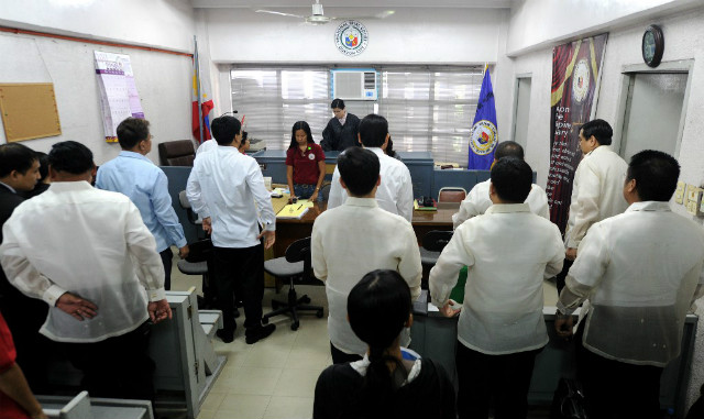 BRANCH 221. Prosecutors and defense lawyers stand up as Judge Jocelyn Solis Reyes (C), who is presiding over the trial of the country's worst political massacre, enters the court room in Quezon City on June 15, 2011. File photo by Noel Celis/AFP