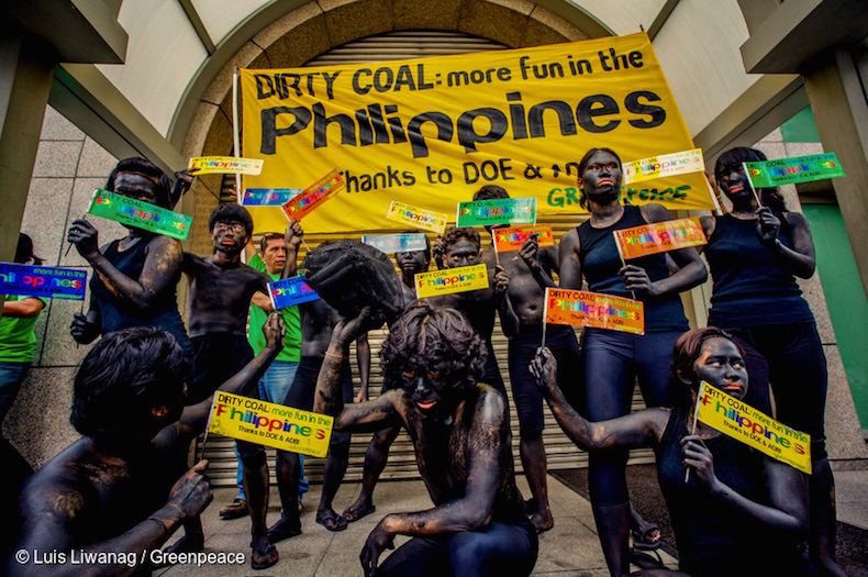 BURNING TRUTH. Environmental advocates paint themselves black to protest against the use of fossil fuels as a source of energy. Photo from Greenpeace