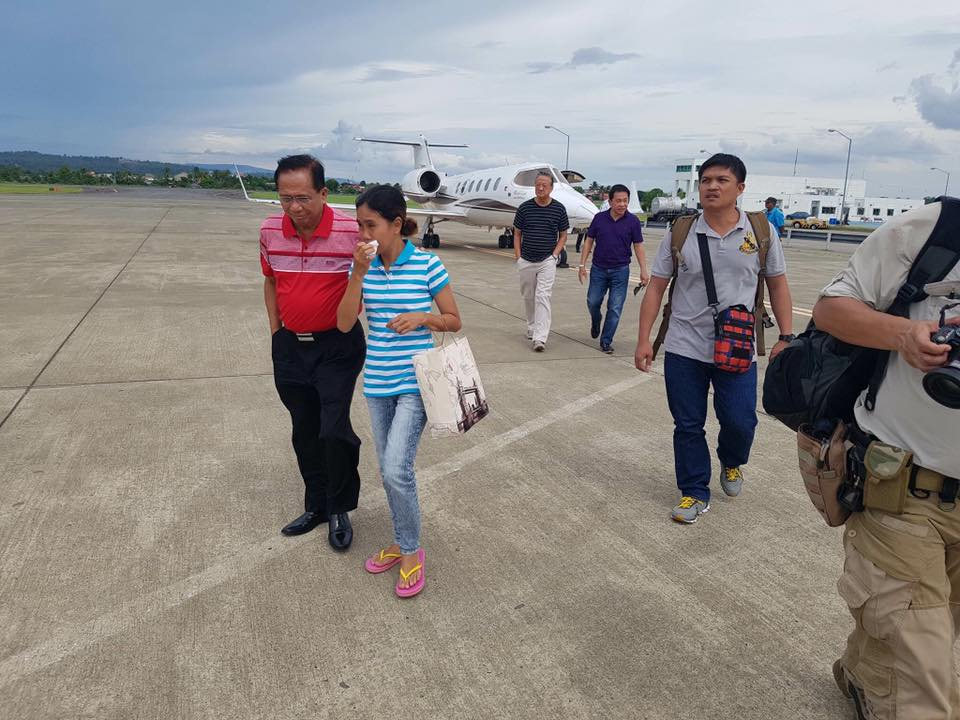 SAFETY. Incoming peace process adviser Jesus Dureza brings hostage Marites Flor to Davao. Photo from Dureza's Facebook page.