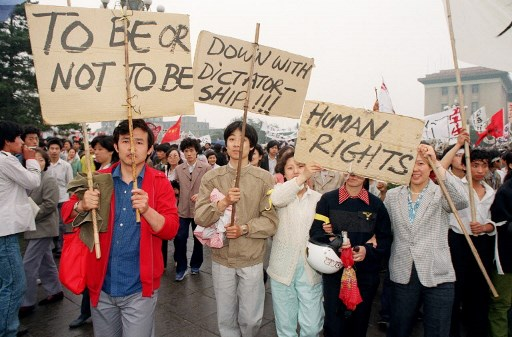 PROTESTS. Beijing residents holding placards written in english walk in procession on May 18, 1989 in support to student hunger strikers who entered the 6th day at Tiananmen Square during u0022Beijing Springu0022 movement.u00a0Photo by Catherine Henriette/AFP