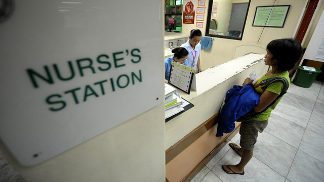 PUBLIC HEALTH. Nurses tend to a woman at the Jose Reyes Memorial Medical Center in Manila. File photo by AFP