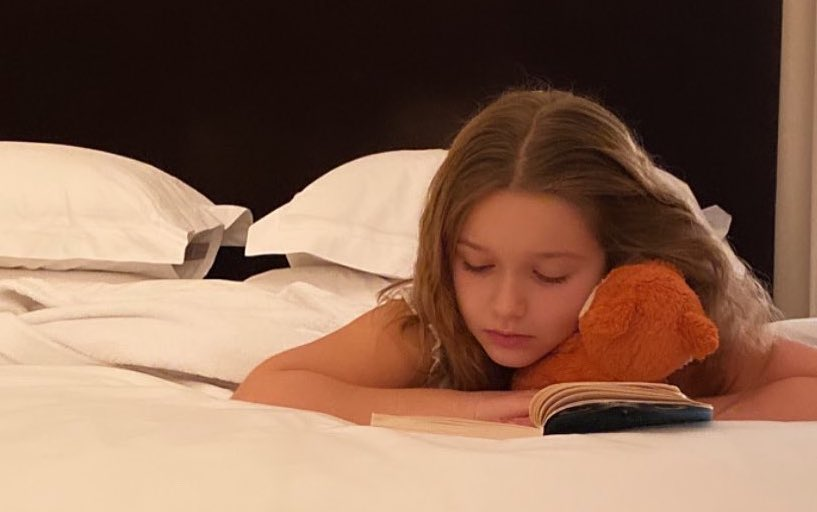 PHONES OFF. Harper Seven Beckham reads books right before going to bed instead of using her devices. Photo from David Beckham's Instagram